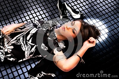 woman lays on grating
