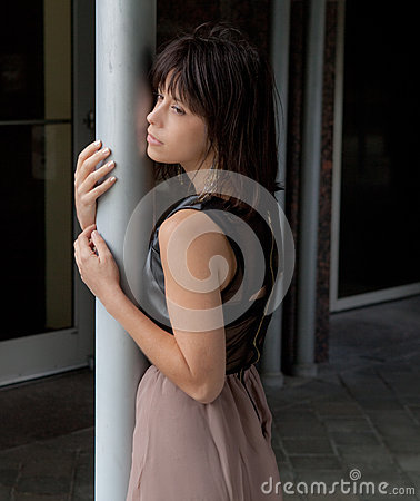 Free Woman Leaning Against Pillar Royalty Free Stock Photography - 34837467