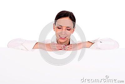 Woman leaning on a billboard