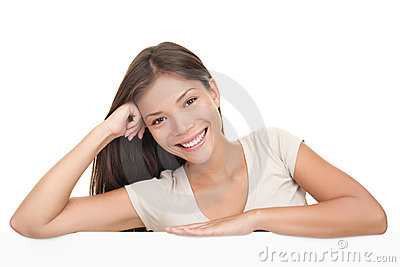 Woman leaning on blank white billboard sign