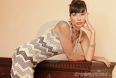Woman leaning on furniture