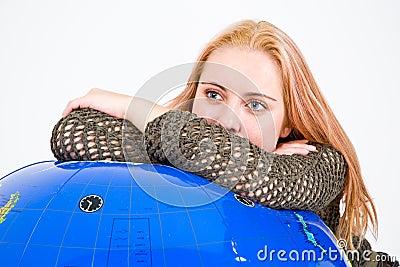 Woman leaning on globe