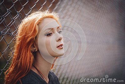 Woman Leaning On Gray Chain Link Fence Free Public Domain Cc0 Image