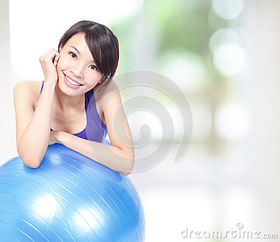 Woman  leaning on a pilates ball