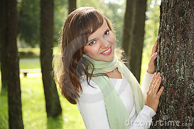 Woman leaning on tree