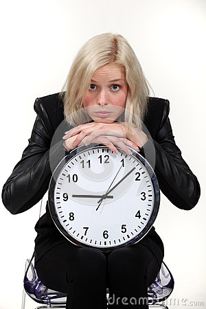 Woman leaning on wall clock