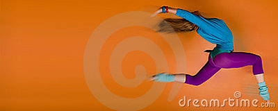 Woman leaping over orange background