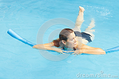 Woman learning swimming with swim