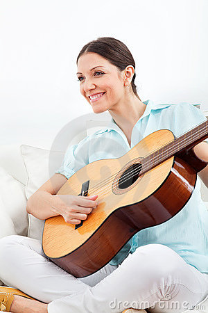 Woman learning to play guitar