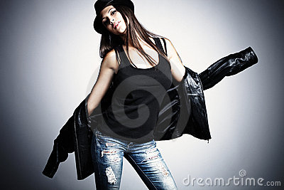 Woman in leather jacket and hat