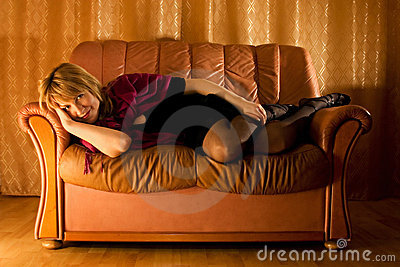 Woman On Leather Loveseat