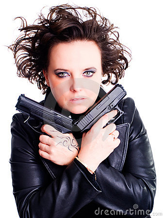 Woman in leather wear holding gun over white