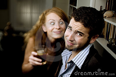 Woman Leers at Man at Party