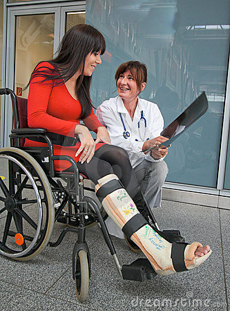 Woman with leg in plaster, a physician and chair