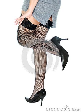 Woman legs in black stockings.