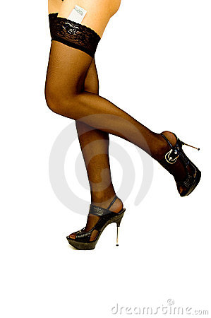 Woman legs in black stockings and high heel shoes