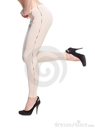 Woman legs in fawn leggins and black shoes
