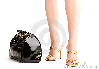 Woman legs and a handbag
