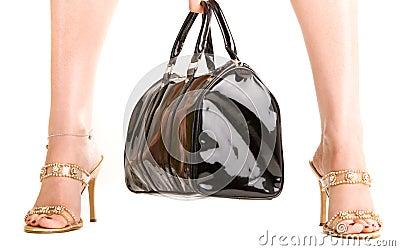 Woman legs and a handbag