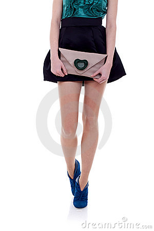 Woman legs and little purse