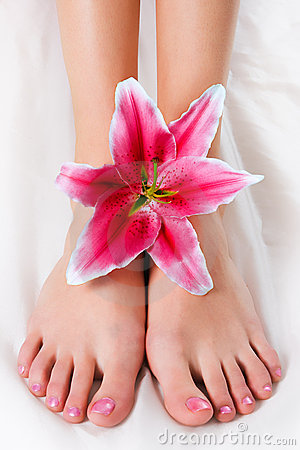 Woman legs with pink lily
