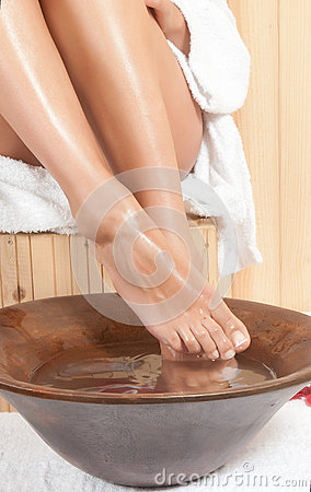 Woman legs in spa