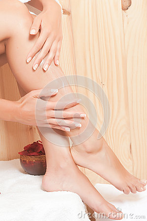 Woman legs in spa