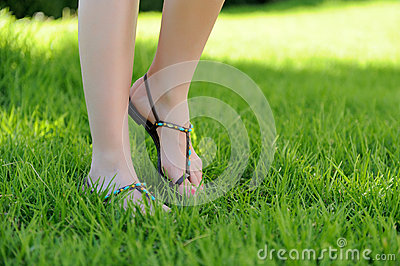 Woman legs walking on grass