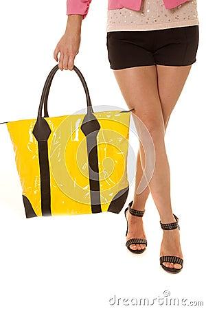 Free Woman Legs Yellow Bag Hold Legs Crossed Stock Image - 33681381