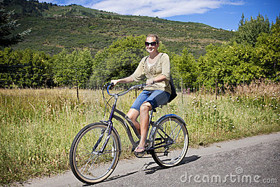 Woman on a Leisure Bike Ride in the Mountains