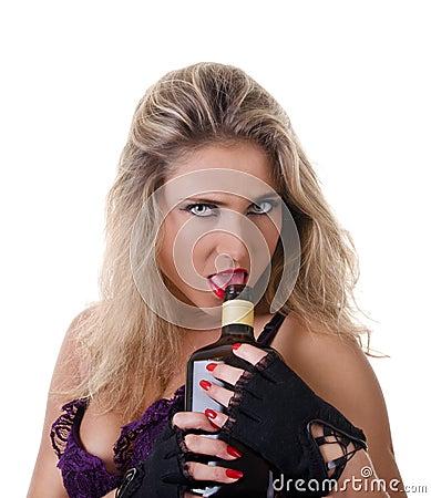 Woman licks the alcohol bottle