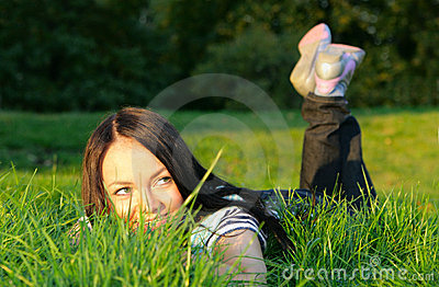 Woman lie on grass