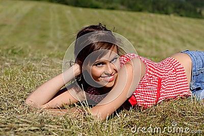 Woman lie on green grass