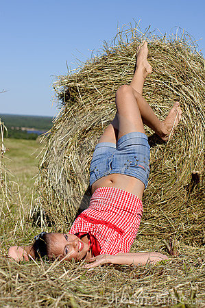 Woman lie near haystack