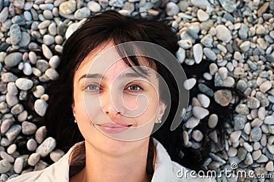 Woman lie on the stone beach