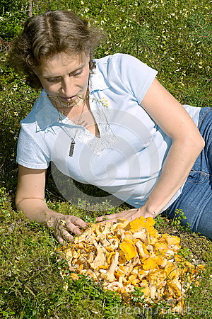 A woman lies on a lawn near the chanterelle