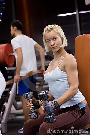 Woman lifting heavy dumbbells