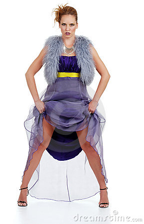 Woman lifting her purple dress with attitude