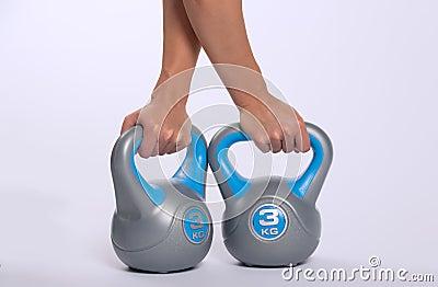 Woman lifting kettlebell weights