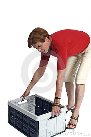 Woman Lifting Storage Box Royalty Free Stock Images - Image: 3103129