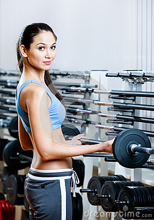 Woman lifts dumbbells
