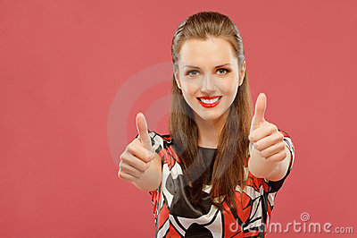 Woman lifts thumbs upwards as sign