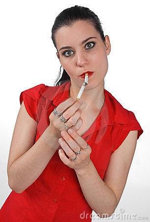 Woman light one cigarette with another