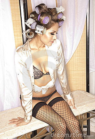 Woman in lingerie and curlers