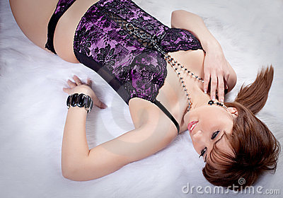 woman in lingerie lying on fur