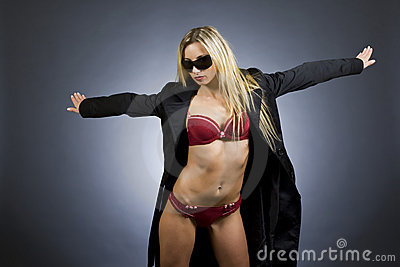 Woman in Lingerie and Overcoat