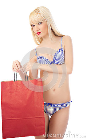 Woman in lingerie with shopping bag