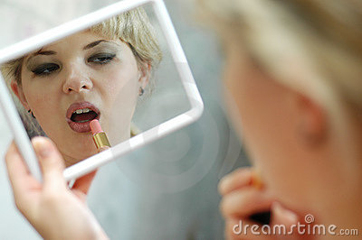 Woman with lipstick and mirror