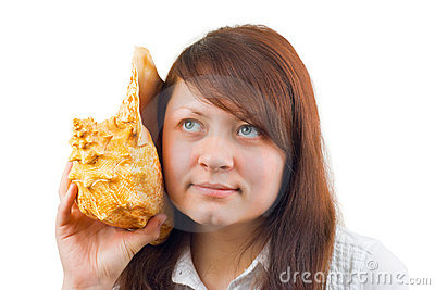 Woman listening big conch