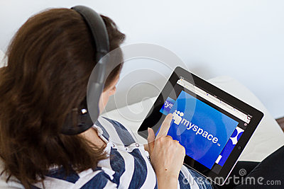 Woman listening music on Myspace Editorial Photography